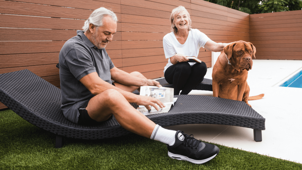 man and woman with their dog just purchased life insurance
