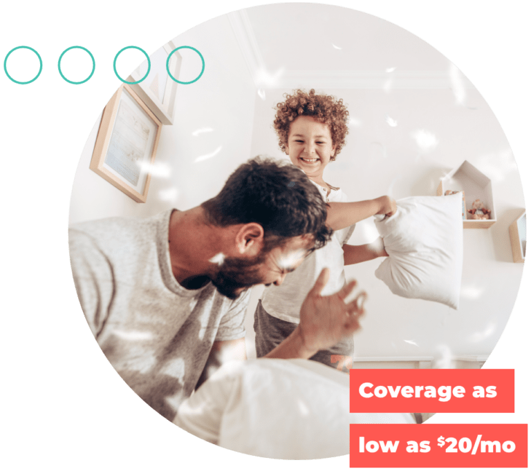 Father and son playing pillow fight, just qualified for term life insurance with Quility