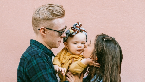 Father, Mother and daughter group hug, just qualified for term life insurance with Quility