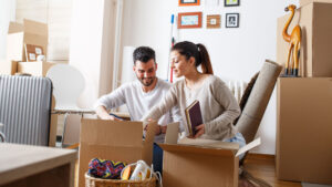 husband and wife in living room, protected with mortgage protection insurance