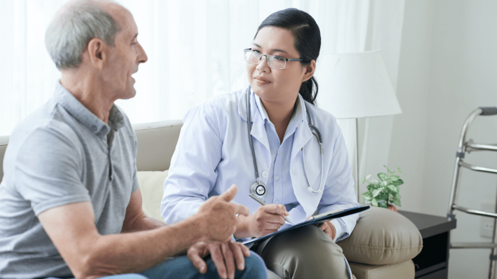 man meeting with doctor asking if qualify for life insurance with a critical illness