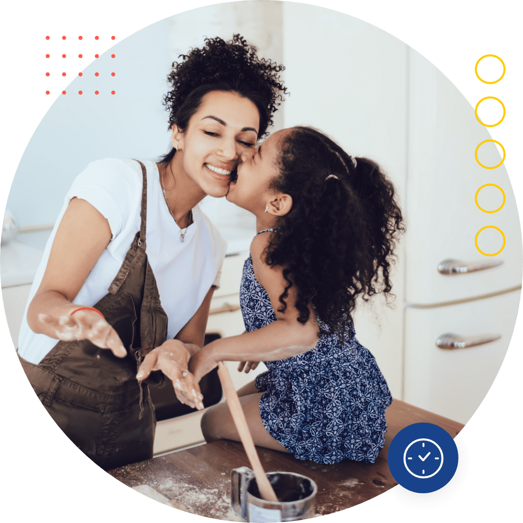 Mother and daughter baking together in kitchen, just qualified for term life insurance with Quility