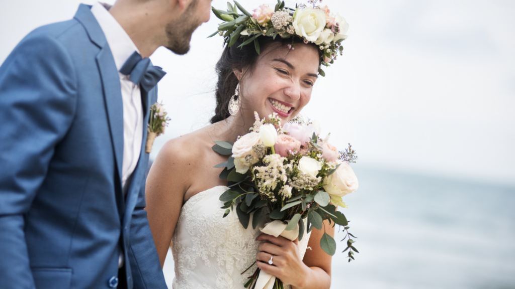two people getting married which could trigger the need for new life insurance policy