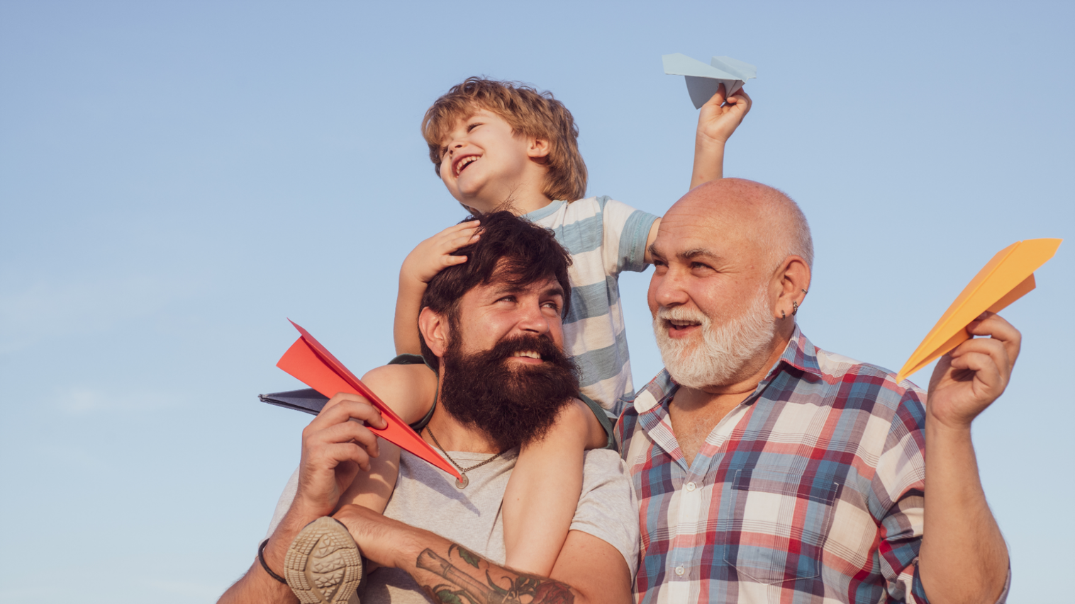 father grandfather and young son with life insurance benefits
