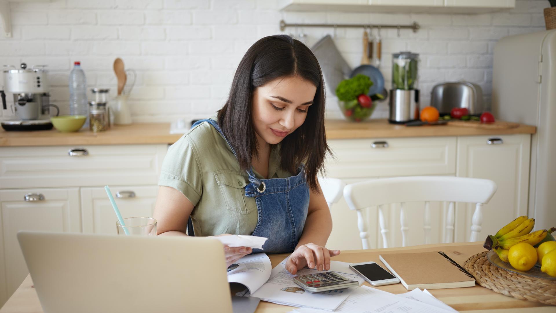 woman paying bills using debt free life program