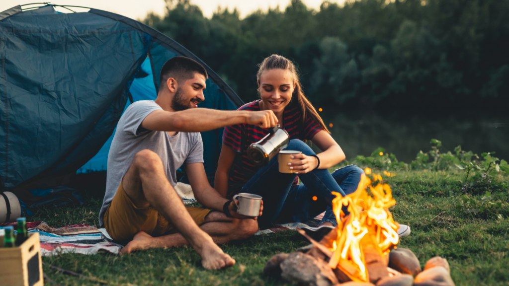 couple by campfire with life insurance