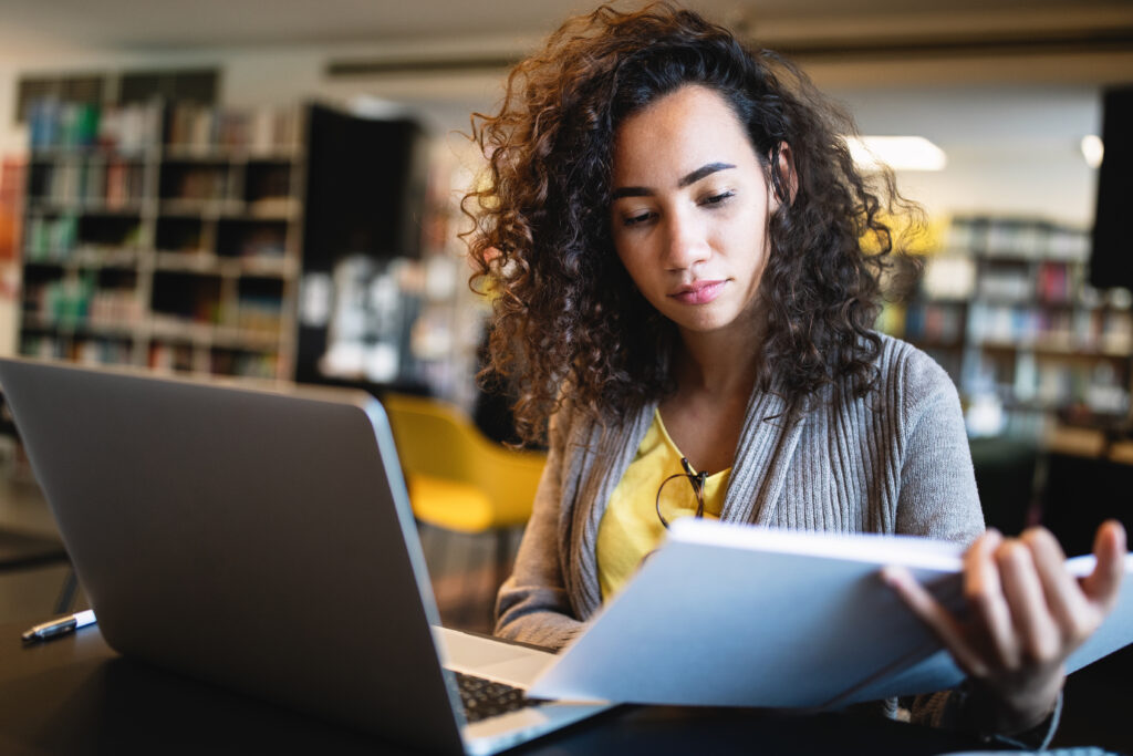 woman on computer i have debt is life insurance right for me